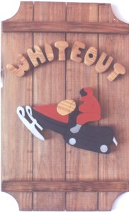 Snowmobile on a 3 board sign.