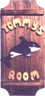 Killer Whale on a 3 board sign.