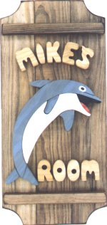 Porpoise on a 3 board sign.