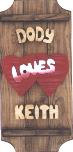 Hearts on a 3 board sign.