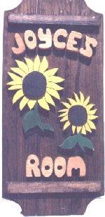Sunflowers on a 3 board sign.