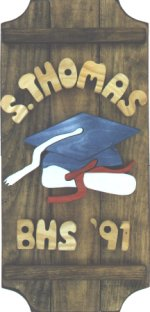 Graduation on a 3 board sign.